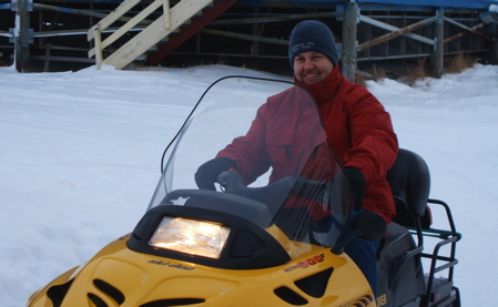 Riding the snowmobile