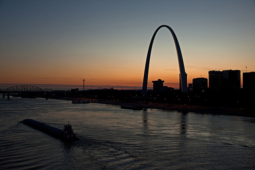 Barge passing by the Arch